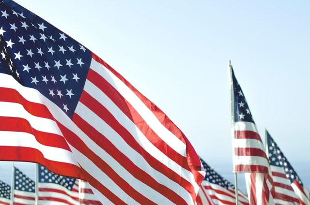 American Flags against a blue sky